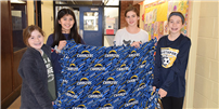 Crafting Cold-Weather Blankets at Northport Middle photo