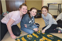 Crafting Cold-Weather Blankets at Northport Middle photo 3